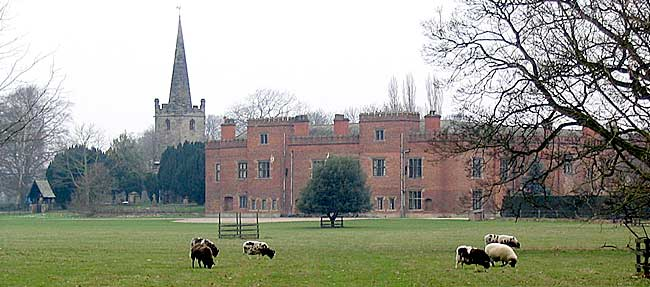 Holme Pierrepont Hall and church in 2004. The brick south entrance range seen here dates from the early 16th century.