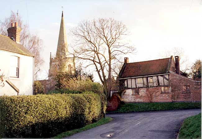 Scrooby church and Brewster's Cottage (photo: A Nicholson, 1998).